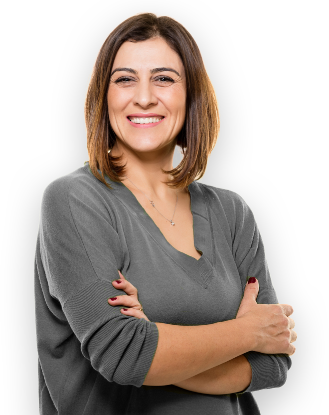 smiling woman with arms crossed